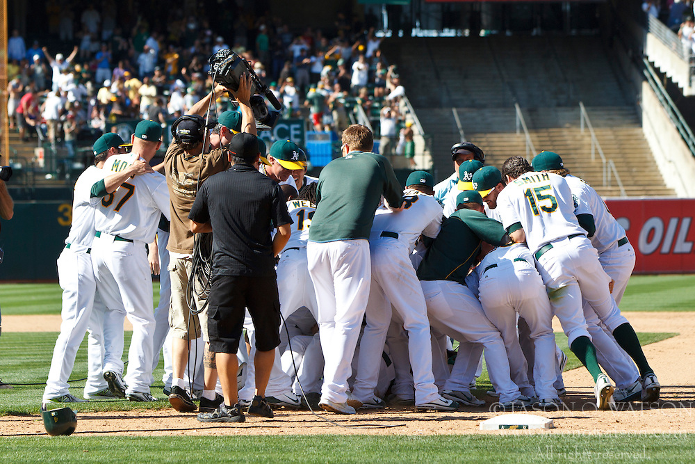 OAKLAND, CA - JULY 22: The Oakland Athletics celebrate after the game against the New York Yankees at O.co Coliseum on July 22, 2012 in Oakland, California.  The Oakland Athletics defeated the New York Yankees 5-4 in 12 innings. (Photo by Jason O. Watson/Getty Images) *** Local Caption ***