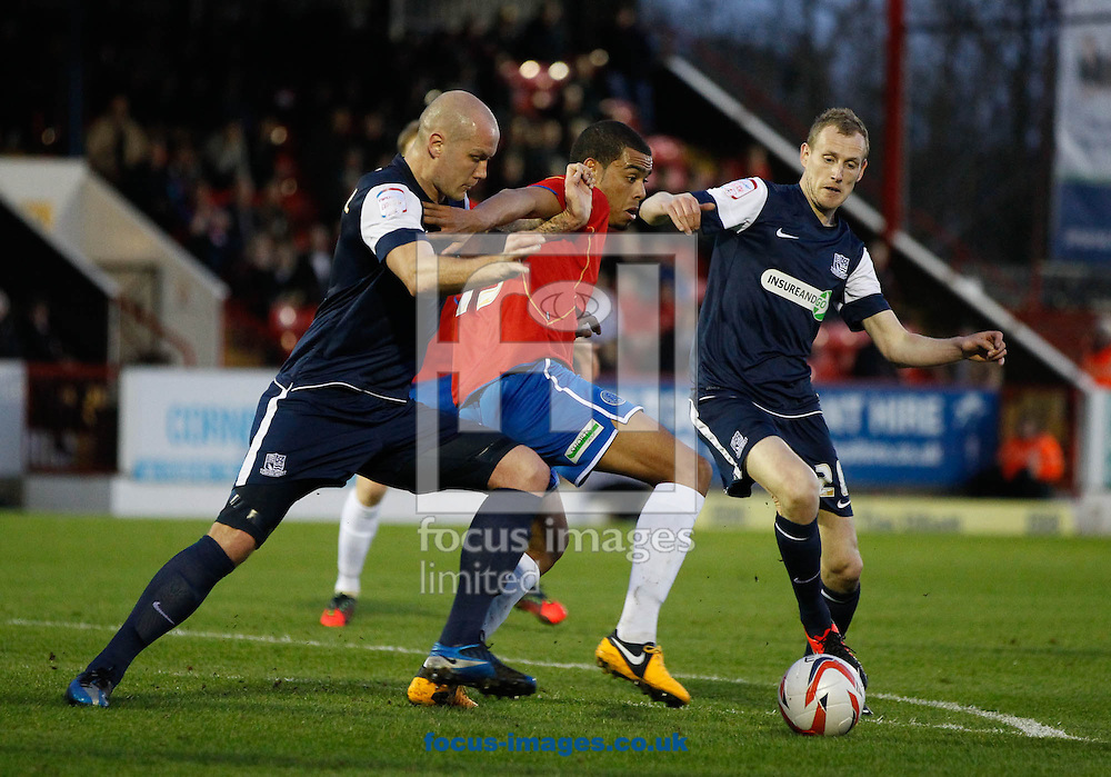 Picture by Andrew Tobin/Focus Images Ltd +44 7710 761829.16/04/2013. Paul McCallum of Aldershot Town (C) battles with Sean Clohessy of Southend United (L) during the npower League 2 match at the EBB Stadium, Aldershot.