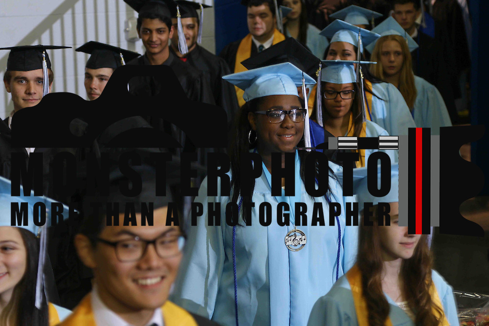 John Dickinson High School graduates participates in a graduation processional during John Dickinson 55th commencement exercises Saturday, June 06, 2015, at The Bob Carpenter Sports Convocation Center in Newark, Delaware.