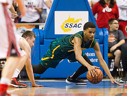 Huntington forward Dajon Congleton (10) dives for a loose ball against Hurricane during a semi-final game at the Charleston Civic Center.