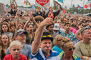 Whiles fans cheer behind a man at the front is clearly not a fan - Jeremy Corbyn is introduced to an enthusiastic crowd at the Pyramid Stage by Michael Eavis - The 2017 Glastonbury Festival, Worthy Farm. Glastonbury, 24 June 2017