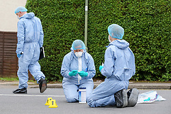 © Licensed to London News Pictures. 19/06/2019. London, UK. Forensic officers next to evidence markers on Wellbeck Road, Barnet, North London  where three men were found to be suffering stab injuries on Tuesday 18 June 2019, just before 11pm. A man in his 30s was treated at the scene, but he was pronounced dead shortly after midnight. Two other men – one in his 20s and one in his 30s were taken to hospital for treatment.  Photo credit: Dinendra Haria/LNP