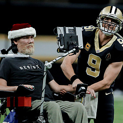 Dec 24, 2017; New Orleans, LA, USA; New Orleans Saints quarterback Drew Brees (9) leads the who dat chant with former player Steve Gleason who suffers from ALS prior to kickoff of a game against the Atlanta Falcons at the Mercedes-Benz Superdome. Mandatory Credit: Derick E. Hingle-USA TODAY Sports