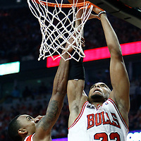 10 May 2011: Chicago Bulls forward Taj Gibson (22) dunks the ball over Atlanta Hawks guard Jeff Teague (0) during the Chicago Bulls 95-83 victory over the Atlanta Hawks, during game 5 of the Eastern Conference semi finals at the United Center, Chicago, Illinois, USA.