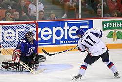 Goalkeeper of Slovenia Andrej Hocevar and Lubomir Visnovsky of Slovakia at ice-hockey game Slovenia vs Slovakia at second game in  Relegation  Round (group G) of IIHF WC 2008 in Halifax, on May 10, 2008 in Metro Center, Halifax, Nova Scotia, Canada. Slovakia won after penalty shots 4:3.  (Photo by Vid Ponikvar / Sportal Images)