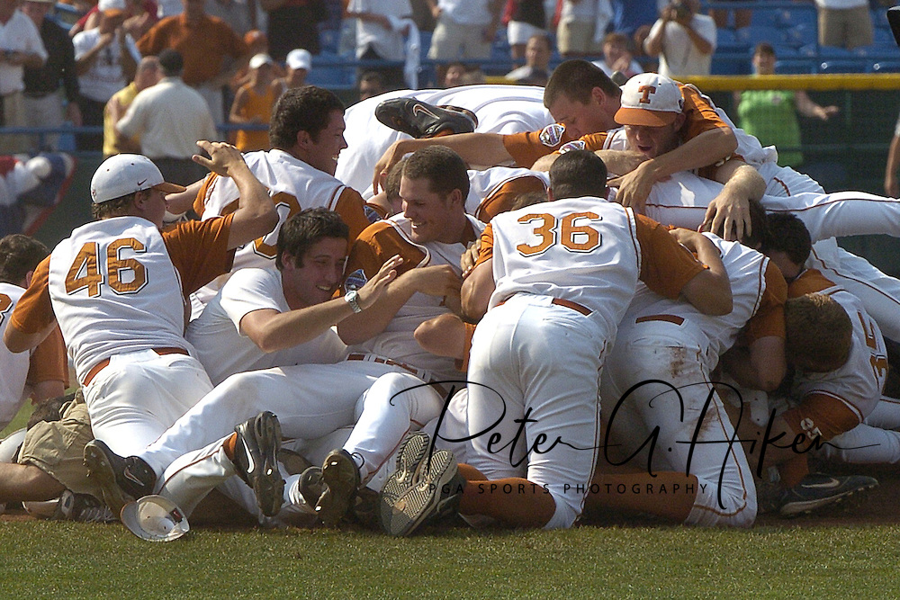Players from the University of Texas celebrate in the center of the field after defeating the University of Florida for the National Championship at the College World Series at Rosenblatt Stadium in Omaha, Nebraska on June 26, 2005.