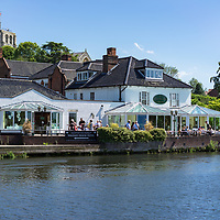 People dining outside on the river in Bungay, Suffolk, England