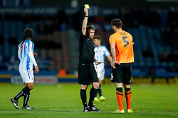 Lewis Dunk of Brighton is shown a yellow card by referee Gary Sutton - Photo mandatory by-line: Rogan Thomson/JMP - 07966 386802 - 21/10/2014 - SPORT - FOOTBALL - Huddersfield, England - The John Smith's Stadium - Huddersfield Town v Brighton & Hove Albion - Sky Bet Championship.