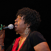 Whether she is singing the classic &lsquo;Throw It Away,&rsquo; a tribute to Ancestor Animata Moseka, &lsquo;Willow Weep for Me,&rsquo; &lsquo;It&rsquo;s Tough Being Green,&rsquo; or any number of jazz, soul, and blues renditions, Faye Carol is intense, investing her lyrics with her life and what it is about in the moment.<br /> <br /> And this past June 10th, Carol&rsquo;s performance at the Black Repertory Theater in Berkeley was no different. <br /> <br /> Her red hot soul fundraising concert for the Music In The Community organization she has founded and grown like Tupac&rsquo;s &lsquo;Rose That Grew From Concrete&rsquo; combined her student&rsquo;s powerful one woman play taking us to the roots of courage and tradition by expressing the truth that true Black Woman / Manhood has not left us; Miss Carol&rsquo;s voice blended soul, jazz, blues and funk with the greatest of ease.<br /> <br /> Faye spoke of respecting and of teaching Black youth. She spoke of respecting Dr. Martin Luther King, Jr. She spoke of growth and of truth.<br /> <br /> She took her shoes off. And got comfortable. And folded all of this understanding and knowledge into our lives; poured it out through a microphone, giving us the warmth we needed that had nothing to do with the temperature outside the door.<br /> <br /> And into this space freely given, the audience returned its appreciation.<br /> <br /> Spirits lifted as she sang this infusion into her music; minds cleared, hearts beat stronger and to surer rhythms than they did perhaps when they came into the show. <br /> <br /> Backed by the stellar performances of Marco Casasola on piano, Marcus Shelby on bass, Geechi Taylor on drums, and Howard Wiley on saxophone, the dynamic Faye Carol continued her timeless tradition of giving, and making all better by her presence. She sizzled red-hot soul with the greatest of ease, transforming two shows into standing ovation fusion while rocking the House of Birel L. Vaughn, Berkeley&rsquo;s own Bla