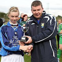 Rachel Kelliher being presented with the MOTM Award by Ronnie Pyne CSSL.<br /> Photograph by Flann Howard