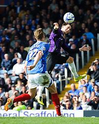 Fabian Broghammer (GER) of Bristol Rovers heads the ball - Photo mandatory by-line: Rogan Thomson/JMP - 07966 386802 - 19/04/2014 - SPORT - FOOTBALL - Fratton Park, Portsmouth - Portsmouth FC v Bristol Rovers - Sky Bet Football League 2.