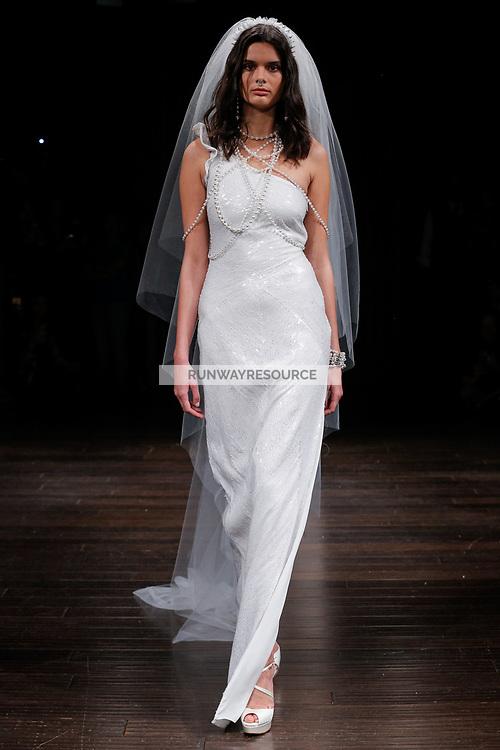 A model walks the runway wearing Naeem Khan Bridal Spring 2018