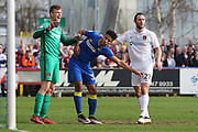 Northampton Town goalkeeper Adam Smith (1) and Northampton Town midfielder John-Joe O'Toole (21) deal with AFC Wimbledon striker Lyle Taylor (33) during the EFL Sky Bet League 1 match between AFC Wimbledon and Northampton Town at the Cherry Red Records Stadium, Kingston, England on 11 March 2017. Photo by Stuart Butcher.