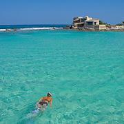 Woman snorkeling at North beach, Isla Mujeres, Quintana Roo. MX.
