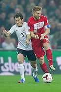(R) Poland's Jakub Blaszczykowski fights for the ball with (L) England's Leighton Baines during the 2014 World Cup Qualifying Group H football match between England and Poland at Wembley Stadium in London on October 15, 2013.<br /> <br /> Great Britain, London, October 15, 2013<br /> <br /> Picture also available in RAW (NEF) or TIFF format on special request.<br /> <br /> For editorial use only. Any commercial or promotional use requires permission.<br /> <br /> Mandatory credit:<br /> Photo by © Adam Nurkiewicz / Mediasport