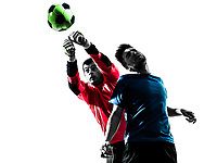 two  soccer player goalkeeper men punching heading ball competition in silhouette isolated white background