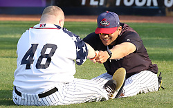 July 5, 2017 - Trenton, New Jersey, U.S - Trenton Thunder Bat Boy (and participant in the Special Olympics) TOMMY SMITH, left, stretches with Thunder Pitching Coach JOSE ROSADO before the game tonight vs. the Fightin Phils at ARM & HAMMER Park. (Credit Image: © Staton Rabin via ZUMA Wire)