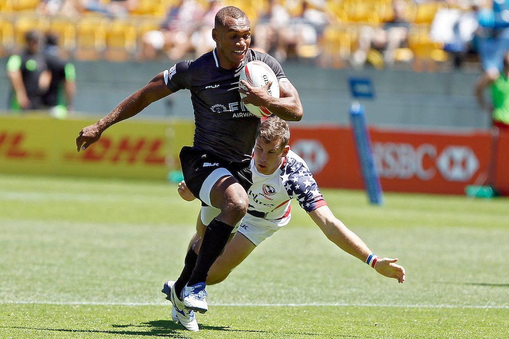 Fiji's Osea Kolinisau, left, runs with the ball as USA's Will Holder, right, attempts a tackle in the International Rugby Sevens Tournament at Westpac Stadium, Wellington, New Zealand, Sunday, January 31, 2016. Credit: SNPA / Dean Pemberton