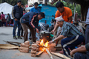 KATHMANDU, NEPAL - APRIL 26: (CHINA OUT)<br /> <br /> Local people make fire to cook on April 26, 2105 in Kathmandu, Nepal. A 8.1-magnitude earthquake struck Nepal on Saturday and the earthquake felt in southeast China\'s Tibet Autonomous Region which brought some houses into collapse. While another 7.1-magnitude earthquake hit the county again the following day afternoon. Chinese government sent out Sichuan Rescue Team, the only one national emergency medical rescue team who could settle camps above an altitude of 3500 meters, to Nepal to support local rescue work and international assistance were also sent to the disaster areas. The earthquake had caused at least 3218 people to death and parts of Chinese visitors were detained in Nepal by Monday morning.<br /> ©Exclusivepix Media