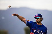 Texas Rangers starting pitcher Yu Darvish (11) pitches with the White Tank Mountains in the background during a spring training workout at the team's training facility on Friday, February 17, 2017 in Surprise, Arizona. (Ashley Landis/The Dallas Morning News)