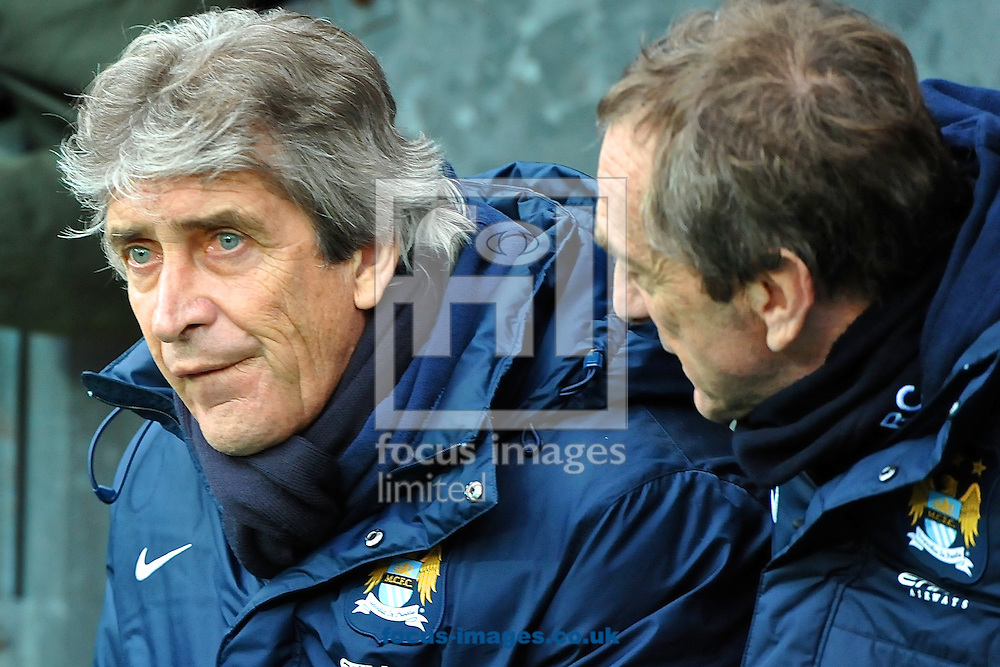 Picture by Ian Wadkins/Focus Images Ltd +44 7877 568959<br /> 04/01/2014<br /> Manchester City manager Manuel Pellegrini (left) in discussion with his assistant Ruben Cousillas ahead of the The FA Cup match at Ewood Park, Blackburn.