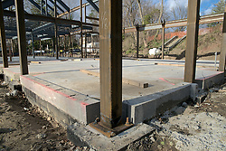 Signs of vandalism are show at the construction site of the Quaker Meeting House in Chestnut Hill.  ..On multiple spots at the construction site  signs of damage are visible on the steel columns of the structure.<br />