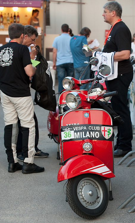 MILAN, ITALY - JUNE 05:  Participants get ready for the start of the Vespa race on June 5, 2010 in Milan, Italy. Vespa is one of the best known Italian icons, the special Vespa weekend is the XV edition of the famous  500km night race  (Photo by Marco Secchi/Getty Images)