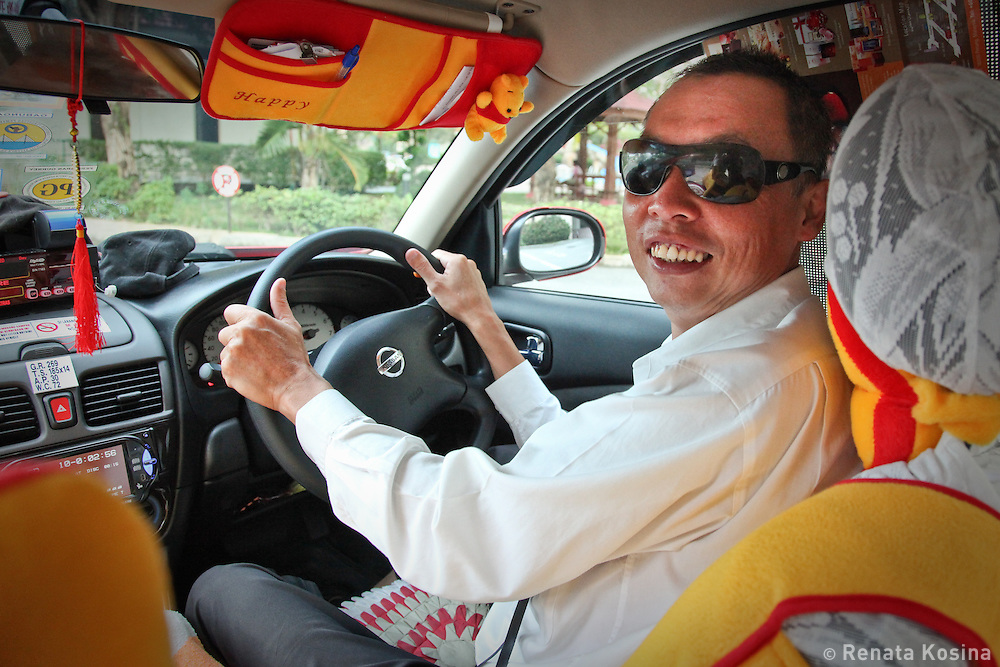 A Malaysian taxi driver of Chinese descent proudly shows off his new car decor in Georgetown on Penang, Malaysia.