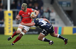 Saracens' Kelly Brown tackled by Sale Sharks Ross Harrison during the Aviva Premiership match at The AJ Bell Stadium, Sale.