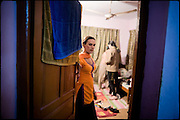 "Koumy, 26 years old, transvestite by the youth, shares a common apartment, where to spend few hours with other friends, also them transvestites belonging to the medium class. Late afternoon in south Rawalpindi, Pakistan on Friday, November 28 2008.....""Not men nor women"". Just Hijira, Kusra. Painted lips, Kajal surrounding their eyes and colourful veils..Pakistan is today considered a strongly, foundamentalist as well, islamic country. But under its reputation, above all over the talebans' continuos advancing, stirs a completely extraneous world, a multiethnic mixed society. Transvestites make part of it, despite this would not be .admitted by a strict law. Third gender, the Hijira are born as men (often ermaphrodites) or with an ambiguous genital situation, and they have their testicles and penis removed through a - often brutal - surgical operation. The peculiarity is that this operation does not contemplate the reconstruction of a female organ. This is the reason why they are not considered as men nor women, just Hijira. They are often discriminated, persecuted  and taxed with being men prostitutes in the muslim areas. The members of this chast perform dances during celebrations, especially during weddings, since it is anciently believed that an EUNUCO's dance and kiss in the wedding day brings good luck to the couple's fertility...To protect the identities of the recorded subjects names and specific places are fictionals."