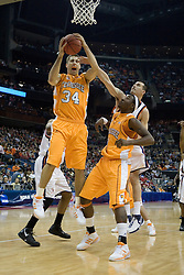 Tennessee Volunteers forward Ryan Childress (34) grabs a rebound against Virginia.  The #4 seed Virginia Cavaliers were defeated by the #5 seed Tennessee Volunteers 77-74 in the second round of the Men's NCAA Tournament in Columbus, OH on March 18, 2007.