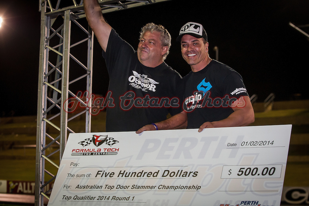 Murray O'Connor (1629) being presented with a Top Qualifier cheque by Formla Tech's Brett Stewart (2542) during round 1 of the 2014 ANDRA Top Doorslammer Championships.