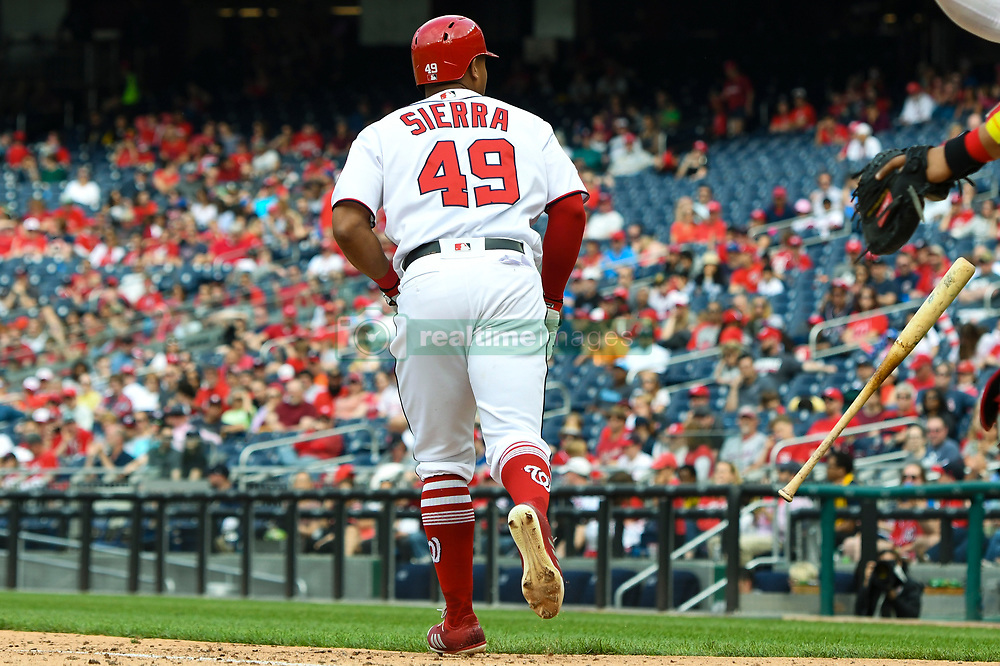 May 6, 2018 - Washington, DC, U.S. - WASHINGTON, DC - MAY 06:  Washington Nationals pinch hitter Moises Sierra (49) tosses his bat after walking in the eighth inning during the game between the Philadelphia Phillies  and the Washington Nationals on May 6, 2018, at Nationals Park, in Washington D.C.  The Washington Nationals defeated the Philadelphia Phillies, 5-4.  (Photo by Mark Goldman/Icon Sportswire) (Credit Image: © Mark Goldman/Icon SMI via ZUMA Press)