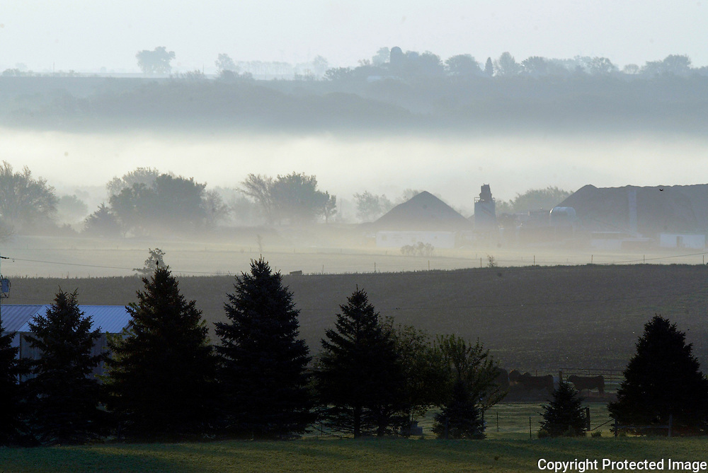 Early morning fog settles in a valley near Cherokee, Iowa.  The rich black soil in this northwest Iowa area produces some of the best crop yields in the country.  13USA, Des Moines, Ia.  Photo by David Peterson13USA, Des Moines, Ia.  Photo by David Peterson