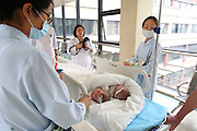 SHANGHAI, CHINA - JUNE 09: (CHINA OUT)<br /> <br /> Siamese Twins Succeed In Separation With Help Of 3D Printed Model<br /> <br /> Siamese girl twins prepare to receive separation surgery at Children\'s Hospital of Fudan University on June 9, 2015 in Shanghai, China. Children\'s Hospital of Fudan University accepted their 8th operations of separation surgery on a pair of siamese girl twins. The seperation surgery focused on the haunches in lower bodies of siamese twins and gained success with the help of 3D printed model which recovered body fabric of the twins in same proportion for medical workers\' accurate reference. It was said that it\'s first time that Children\'s Hospital of Fudan University applied 3D skills on separation surgery and the siamese girl twins were in good condition in their 80 days after birth.<br /> ©Exclusivepix Media