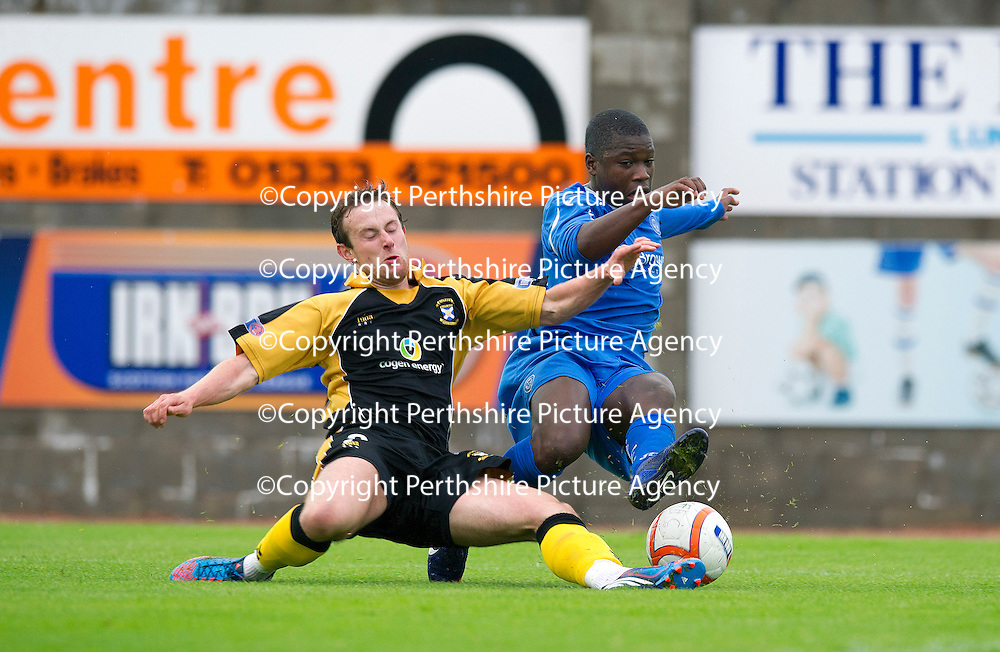 East Fife v St Johnstone...11.07.12  Pre-Season Friendly<br /> New signing Nigel Hasselbaink is tackled by Scott Durie<br /> Picture by Graeme Hart.<br /> Copyright Perthshire Picture Agency<br /> Tel: 01738 623350  Mobile: 07990 594431