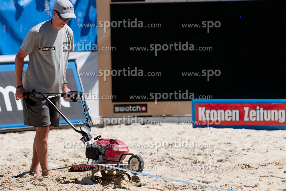 Worker plough the court at A1 Beach Volleyball Grand Slam tournament of Swatch FIVB World Tour 2010, on July 31, 2010 in Klagenfurt, Austria. (Photo by Matic Klansek Velej / Sportida)