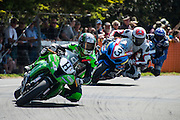 Horst Saiger ( H ) from Liechtenstein leads Sloan Frost from Wellington in the F1 Superbike race at the Cemetery Circuit Road Races, Wanganui, Boxing Day which was the 3rd and final round of the 2014 Suzuki Series