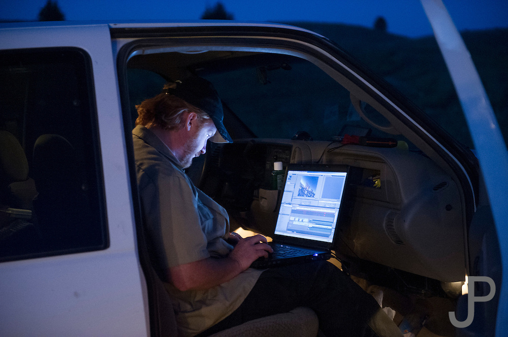 Rawhyde's Adam Stephens works on editing a video clip while camped at Morrison Lake.