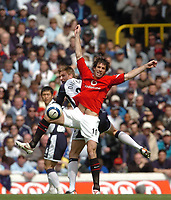 Photo: Leigh Quinnell.<br /> Tottenham Hotspur v Manchester United. The Barclays Premiership. 17/04/2006. Man Utds' Ruud Van Nistelrooy clashes in the air with Tottenhams Calum Davenport.