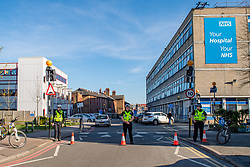 "© Licensed to London News Pictures. 04/04/2020. Watford, UK. Police stand guard at entrances to Watford General Hospital after a critical incident was declared. A statement released said: ""As a result of a technical issue with our individual hospital's oxygen equipment, which does not pose any risk to our patients, West Herts Hospitals NHS Trust declared a critical incident on Saturday April 4 and has asked that people do not attend Watford General Hospital. A small number of patients are being transferred to other hospitals in the area, with each patient being fully assessed in line with existing safety guidelines before they are moved."" Photo credit: Peter Manning/LNP"