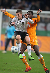 LUKAS PODOLSKI & SOULEYMANE BAMBA.GERMANY V IVORY COAST.GERMANY V IVORY COAST.VELTINS ARENA, GELSENKIRCHEN, GERMANY.18 November 2009.GAA3969..  .WARNING! This Photograph May Only Be Used For Newspaper And/Or Magazine Editorial Purposes..May Not Be Used For, Internet/Online Usage Nor For Publications Involving 1 player, 1 Club Or 1 Competition,.Without Written Authorisation From Football DataCo Ltd..For Any Queries, Please Contact Football DataCo Ltd on +44 (0) 207 864 9121