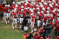 October 23, 2010; Stanford, CA, USA;  Stanford Cardinal head coach Jim Harbaugh and fullback Owen Marecic (48) lead their team onto the field before the game against the Washington State Cougars at Stanford Stadium.