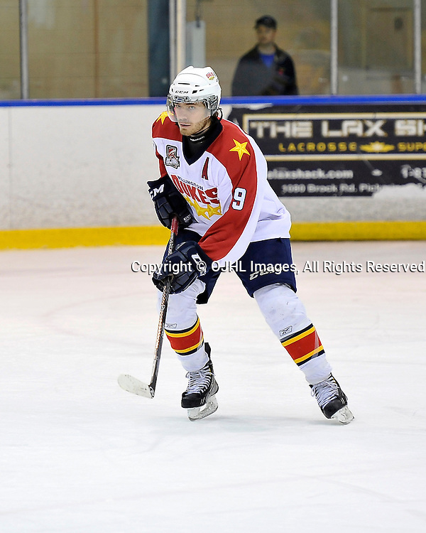 WHITBY, ON - Nov 11, 2014 : Ontario Junior Hockey League game action between Wellington and Whitby. Joe Mckeown #19 of the Wellington Dukes Hockey Club during the first period.<br /> (Photo by Shawn Muir / OJHL Images)