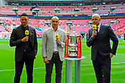 The BBC sport pitchside pundits team with the FA Cup before the The FA Cup Final match between Manchester City and Watford at Wembley Stadium, London, England on 18 May 2019.