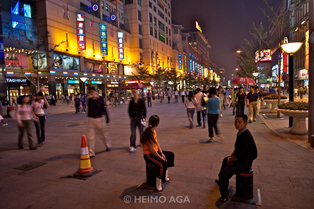 Wangfujing Dajie shopping street and pedestrian zone. Shopping at night.