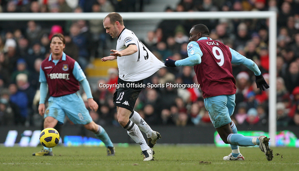 26/12/2010 - Barclays Premier League - Fulham vs. West Ham United - Danny Murphy of Fulham has his shirt pulled as he battles with Carlton Cole of West Ham - Photo: Simon Stacpoole / Offside.