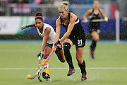 Stacey Michelsen of New Zealand competes against Marsha Cox of South Africa during the bronze medal match between New Zealand and South Africa. Glasgow 2014 Commonwealth Games. Hockey, Bronze Medal Match, Black Sticks Women v South Africa, Glasgow Green Hockey Centre, Glasgow, Scotland. Saturday 2 August 2014. Photo: Anthony Au-Yeung / photosport.co.nz