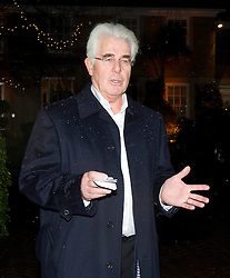 © London News Pictures. 06/12/2012. Walton-on-Thames, UK .  Publicist Max Clifford talking to media as he arrives back at his home in Walton on Thames, Surrey, UK after he was arrested in connection with the Jimmy Savile investigation. Photo credit: Ben Cawthra/LNP