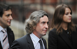 © London News Pictures. 22/11/2011. London, UK.  Comedian STEVE COOGAN (centre) arriving at The Royal Courts of Justice today (22/11/2011) to give evidence at the Leveson Inquiry into press standards. The inquiry is being lead by Lord Justice Leveson and is looking into the culture, and practice of the UK press. The Leveson inquiry, which may take a year or more to complete, comes after The News of The World Newspaper was closed following a phone hacking scandal. Photo credit : Ben Cawthra/LNP